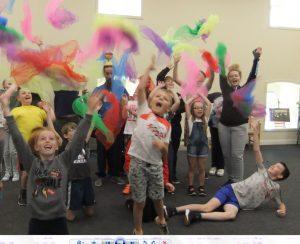 photo of children in an arts class having fun