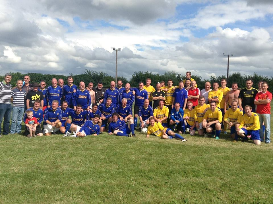 group photo of more than thirty Arlington AFC soccer players from Portarlington