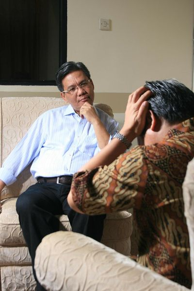 photo of patient in mental distress with therapist