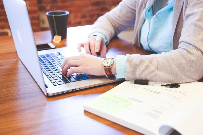 photo of person working on laptop at desk