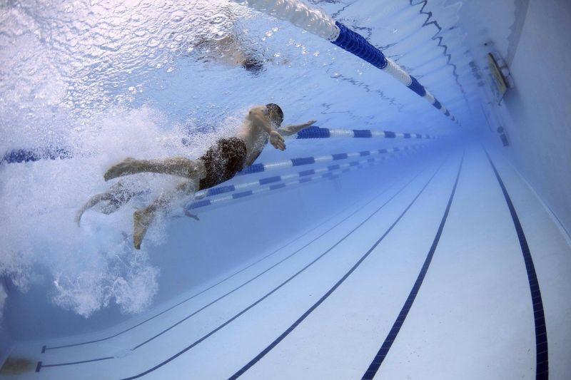 Swimmer underwater in swimming pool