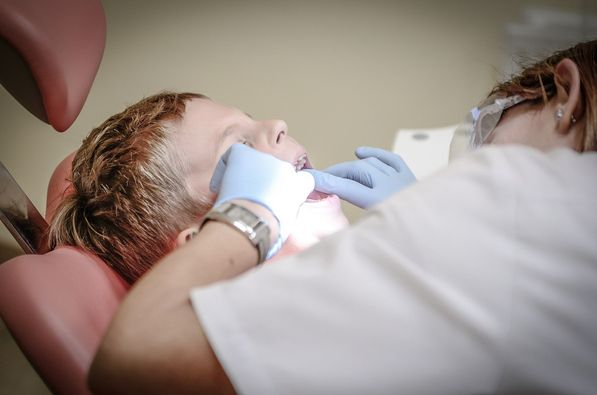 photo of child being treated by dentist