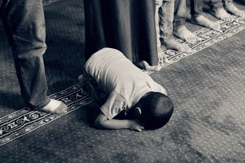 photo of young male worshipping
