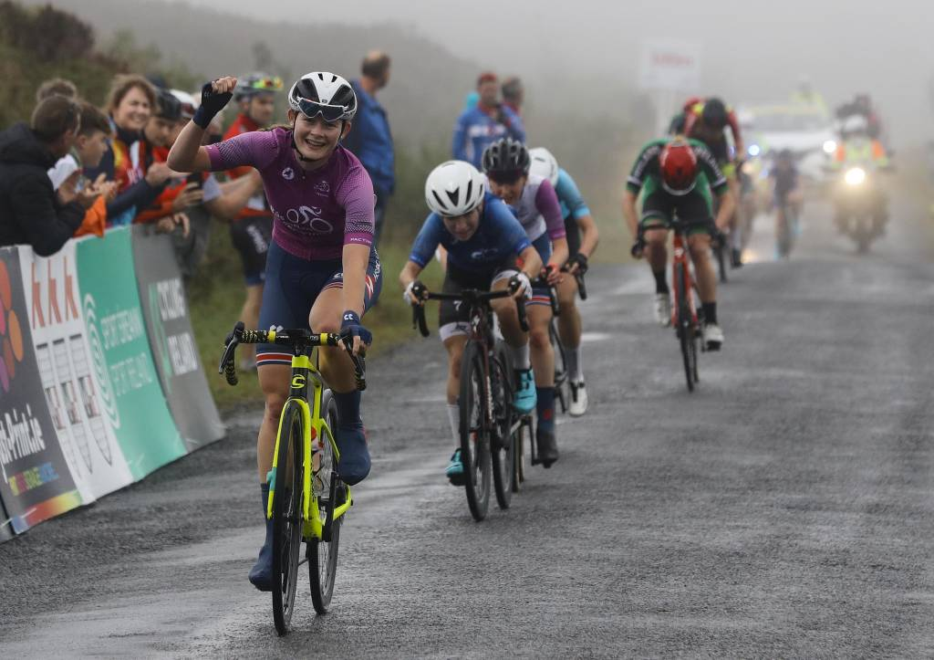 Race leader Abi Smith shrugged off the frustration of two consecutive second place finishes to take victory at the third time of asking at the summit finish on The Cut in County Laois today.
